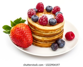 Pile of pancakes with berries, isolated