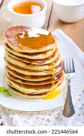 Pile of pancakes with honey, selective focus