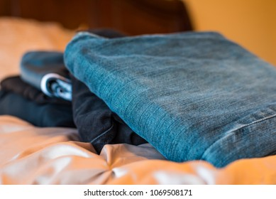 Pile of Pants on Bed