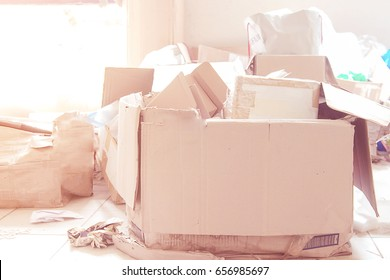 pile of paper box in the storage room be in a messy. unused for recycle