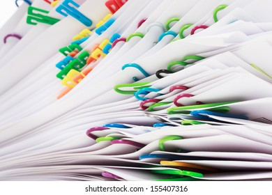 Pile of paper with colorful clips