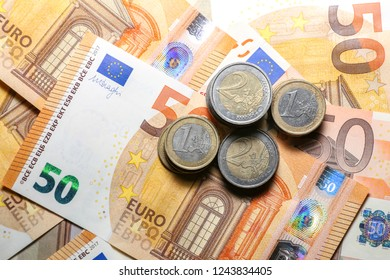 Pile of Paper Euro Banknotes and Coins as Background