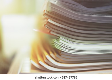 pile of papers in difference colors ready to make a books in paper factory.
