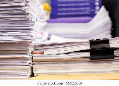 Pile of papers and document stacked on the table close up.