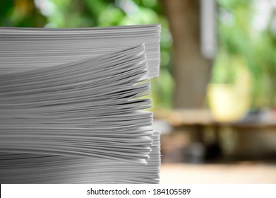 pile of papers green background