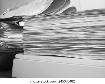 the pile of papers, monochrome