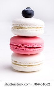 Pile of Pastel Color and Tasty Macarons on White Background White and Pink Macaron Vertical Close Up