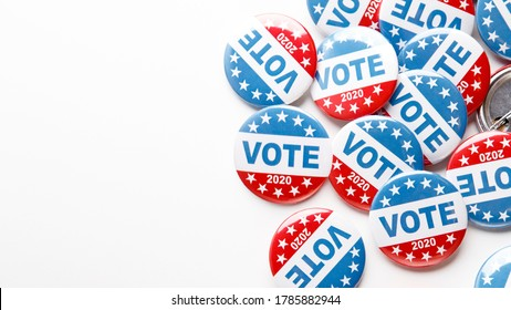 Pile of patriotic voting buttons on white background, panorama, copy space, American presidential elections