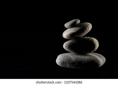 Pile of pebble stones isolated on black background