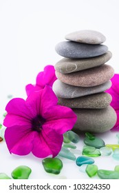 Pile of pebble Stones with purple flower