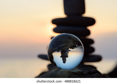 Pile of pebbles reflected inside the crystal ball