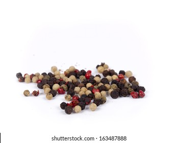Pile of peppercorn isolated over white