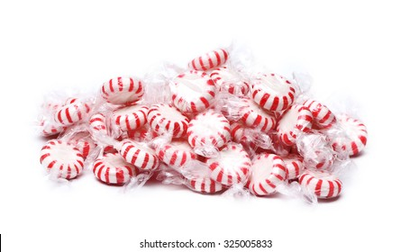 A pile of peppermint candies on a white background