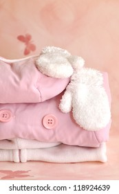 Pile of pink girlie warm winter clothes