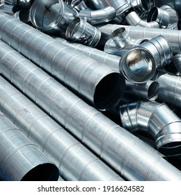 Pile of pipes and parts for duct systems. Industrial ventilation