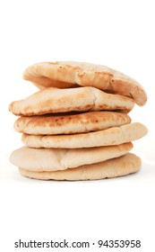 A pile of pita bread on a white background.