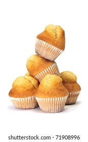 a pile of plain cupcakes on a white background