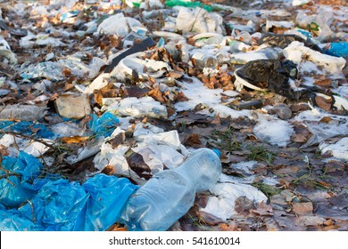 Pile of plastic bags and other refined petroleum products dumped in landfill. Garbage heap gives infiltrate into ground. Waste sorting is required. Lviv city