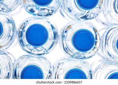 pile of plastic bottles of half litre with blue cap