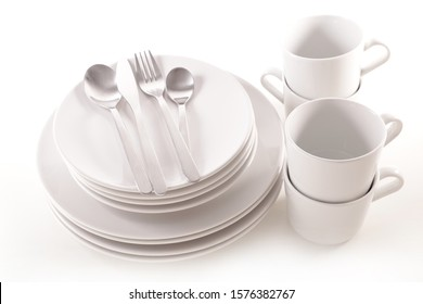 pile of plates empty with mug and bowl isolated on white background