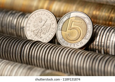A pile of Polish money, PLN coins arranged in composition - Shutterstock ID 1189131874