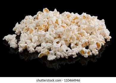 A pile of popcorn on a black background.
