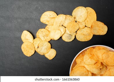 Pile of potato chips. Crisps on background. Potato chips is snack in bag