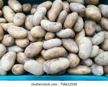 Pile of potato in green basket