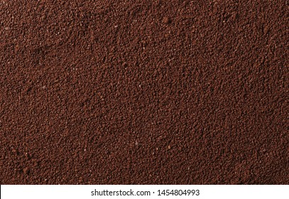 Pile of powdered, instant coffee background and texture, top view