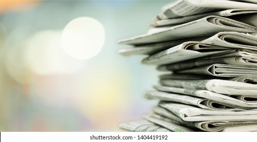 Pile of printed newspapers on background