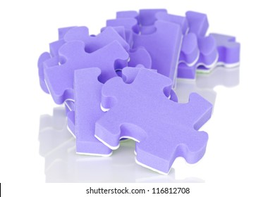 pile of purple puzzle on a white background