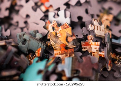 Pile of puzzle pieces close up. A puzzle is a game, problem, or toy that tests a person's ingenuity or knowledge.