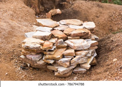 A pile of quarried and broken slates of rock, ready for sale. Shot in Uganda in June 2017.