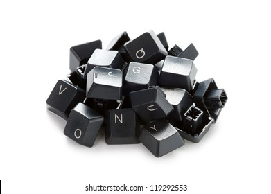 a pile of random computer keyboard keys isolated on a white background