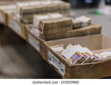 A pile of randomly scattered bundles of banknotes, banknotes in treasury department for cash machine refill