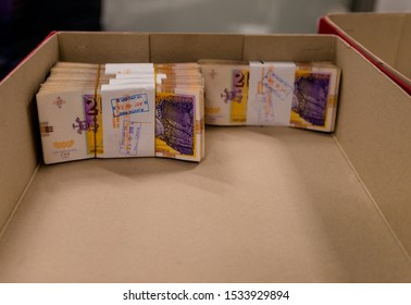 A pile of randomly scattered bundles in box, banknote bills