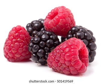 pile of raspberries and blackberries isolated on white background