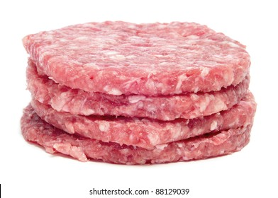 a pile of raw burgers on a white background