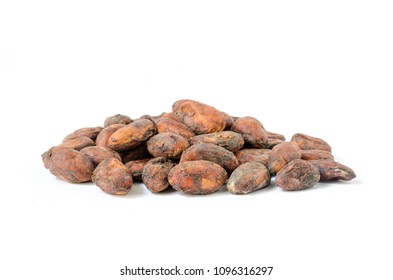 Pile of raw organic unpeeled cacao seeds, isolated. Side view