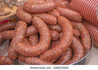 pile of raw sausages ready to cook or grill, shallow focus