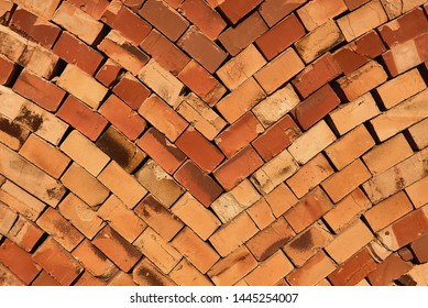 a pile of red building bricks