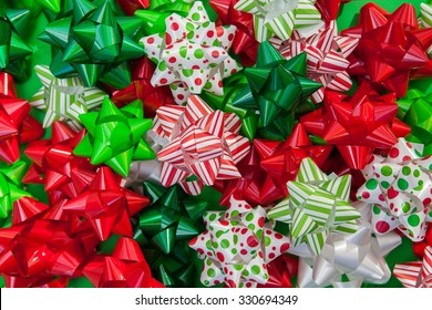 Pile of red, green and white Christmas bows background