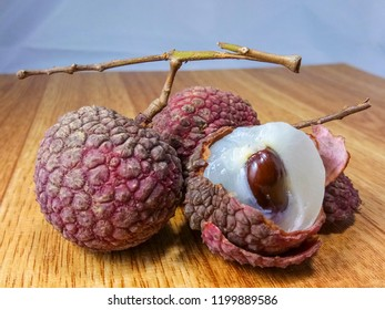 A pile of red Lychees is the sole member of the genus Litchi in the soapberry family, Sapindaceae