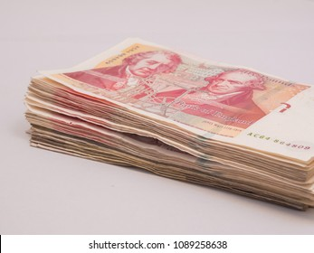 Pile of red pound GBP money on white background financial concept