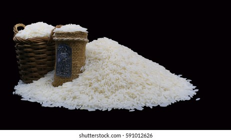 Pile of rice with basket and sack.