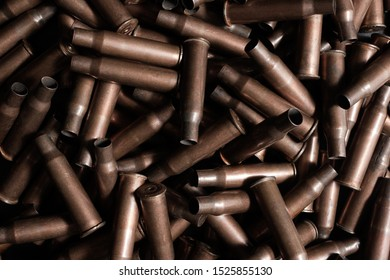 Pile of rifle gun shells laying, upper view.