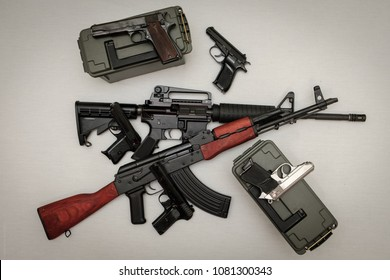 Pile of rifles and hand guns