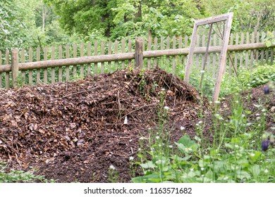 pile with ripe compost and sieve