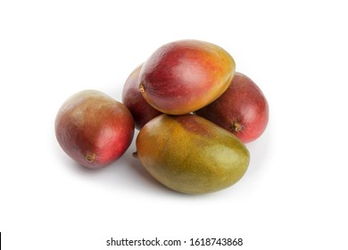 a pile  of ripe natural looking Palmer mangoes on a white table top