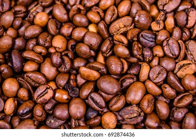 Pile of the roasted coffee beans for background